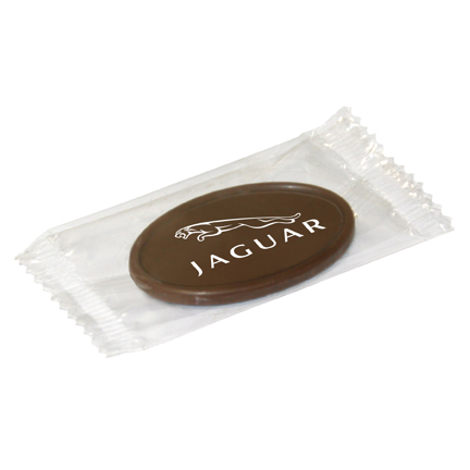 Chocolaatje met logo per stuk verpakt in transparante flowpack